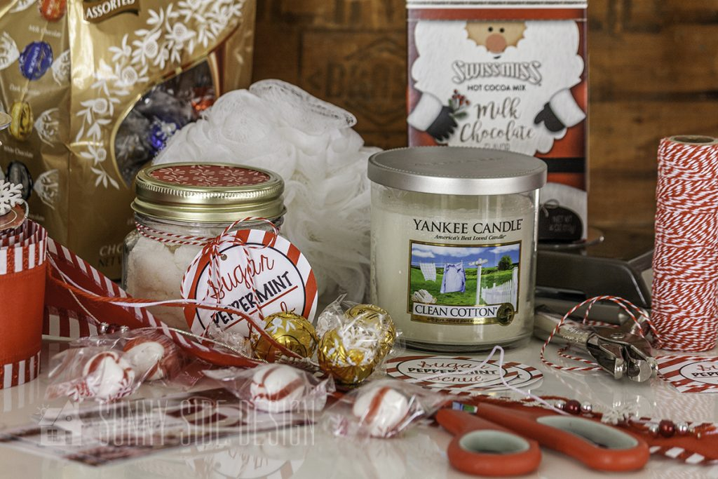 Contents of pampering gift: sugar scrub, candle, chocolates, hot chocolate, mints