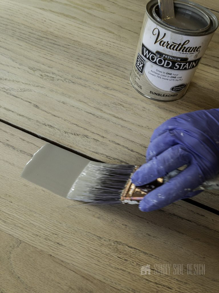 applying stain on wood table top