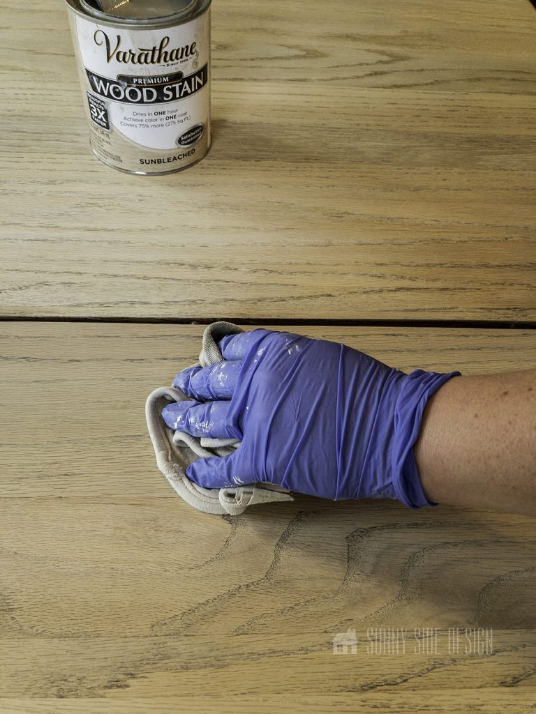 wiping excess stain from wood table top