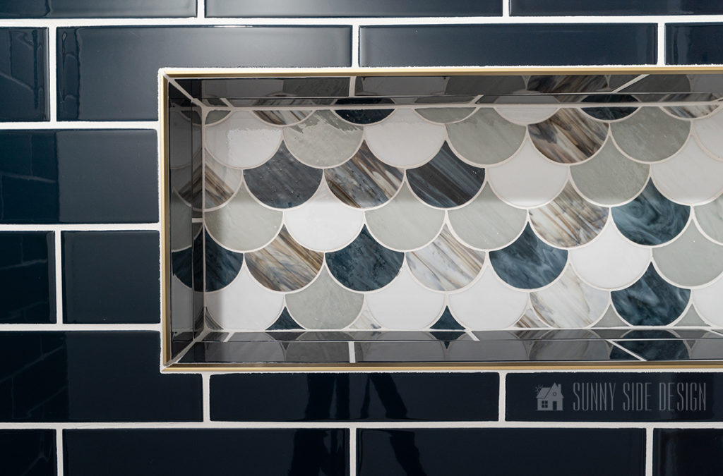 close up of tiled shower niche