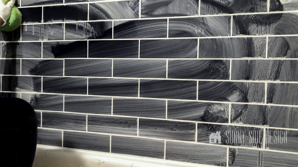 what the tiles look like after initial wipe with wet sponge