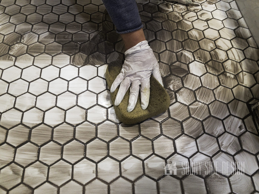 wipe excess grout off hexagon tile after recommended dry time
