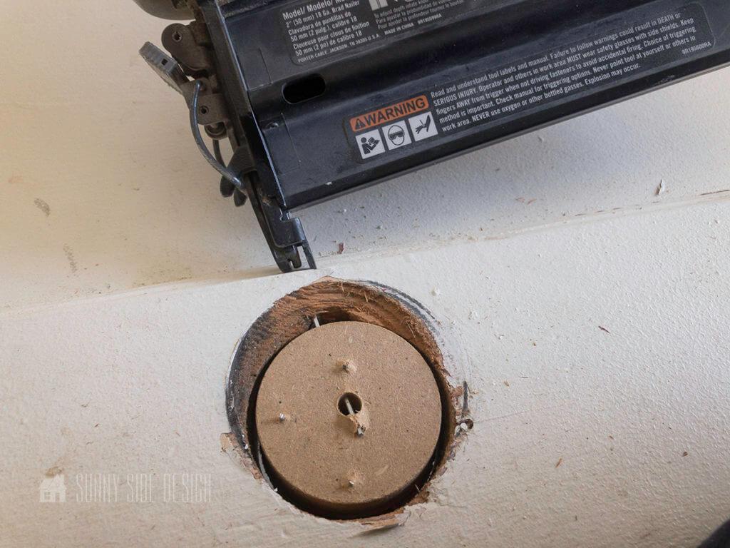 secure cirlce pieces into door handle hole