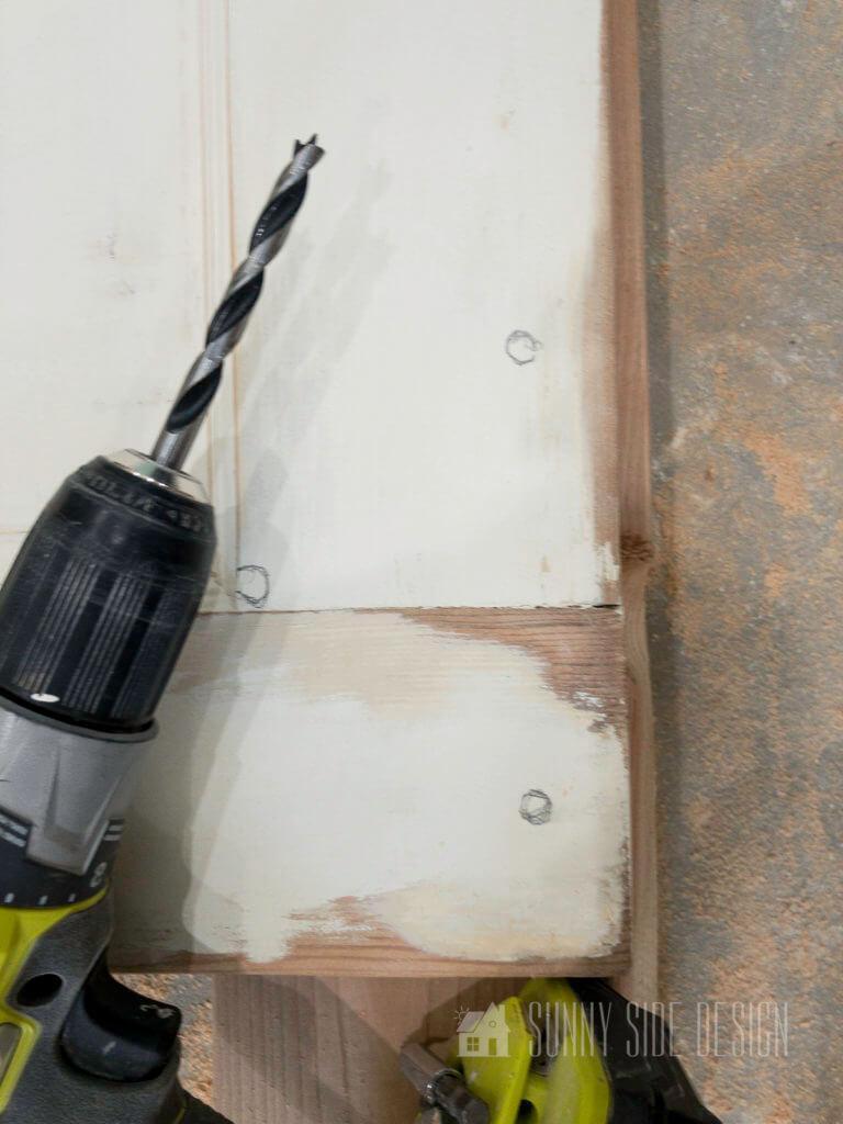 Drill pilot holes for barn door hardware