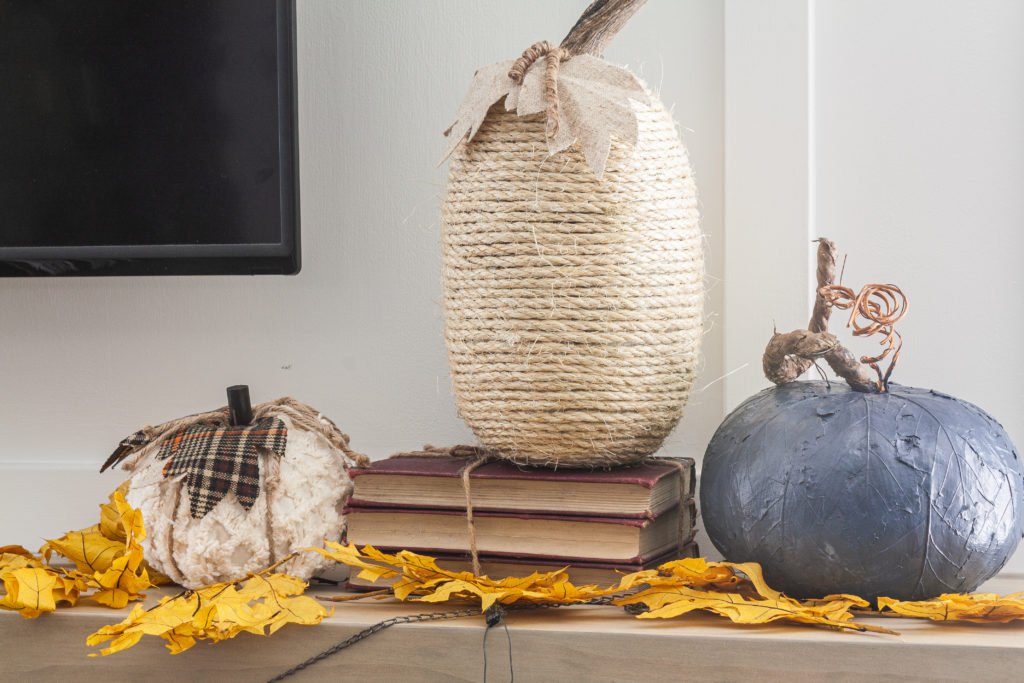Use rope to wrap around a pumpkin form to create a farmhouse or rustic feel with this pumpkin craft idea