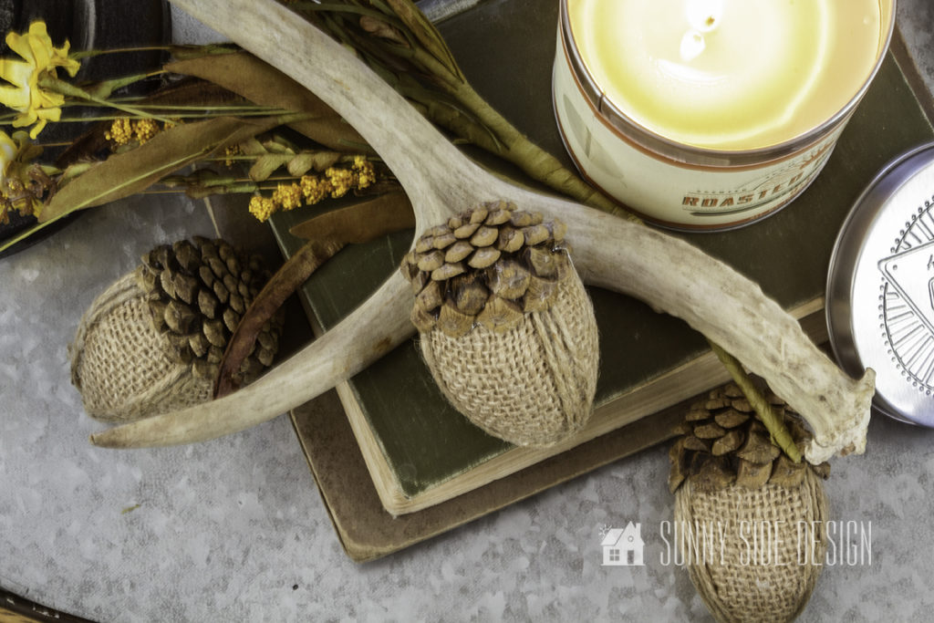 Cozy Fall Decor Ideas for Your Home. Galvanized tray with stacked books, flowers, acorns, antler and burning candle.
