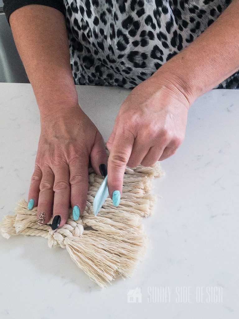 comb out the macrame thread to create a soft leaf look