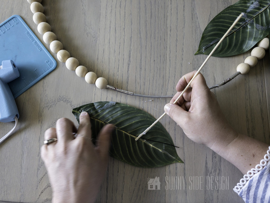 secure wire onto back of each leaf