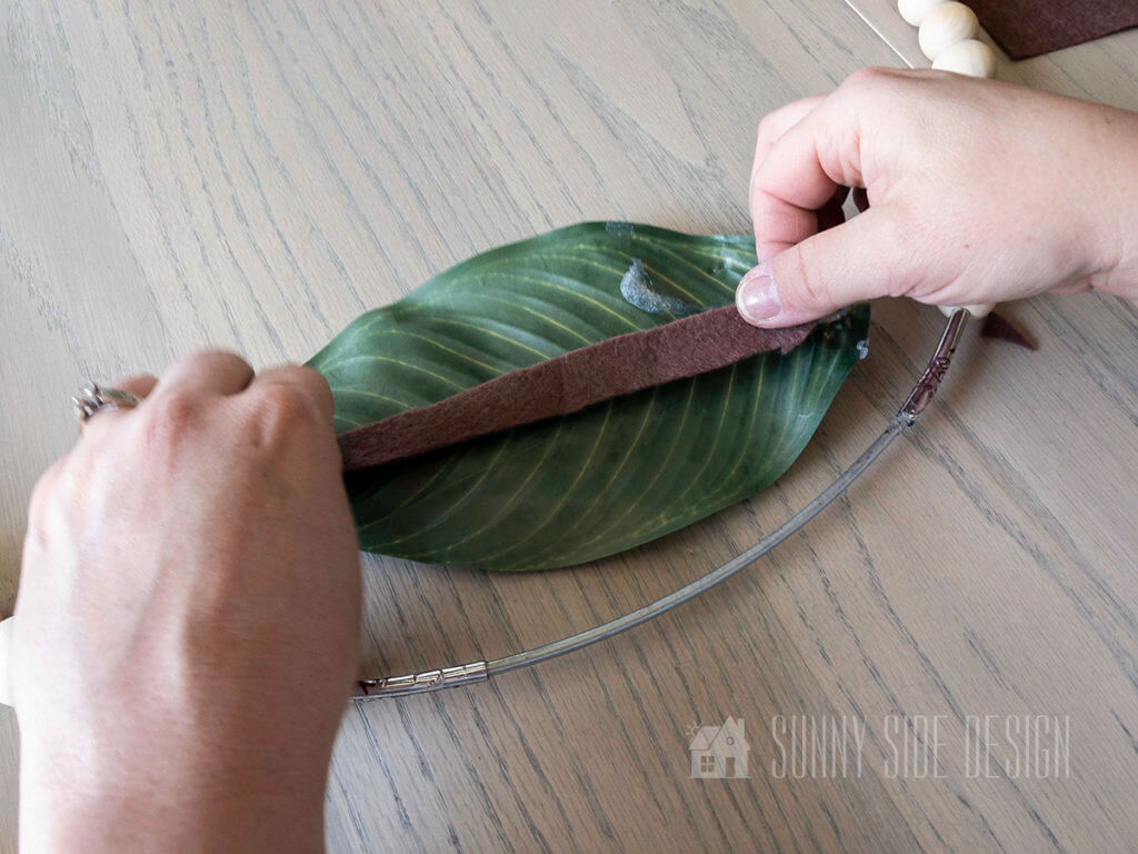 use hot glue to secure felt onto the back of each leaf to cover the wire