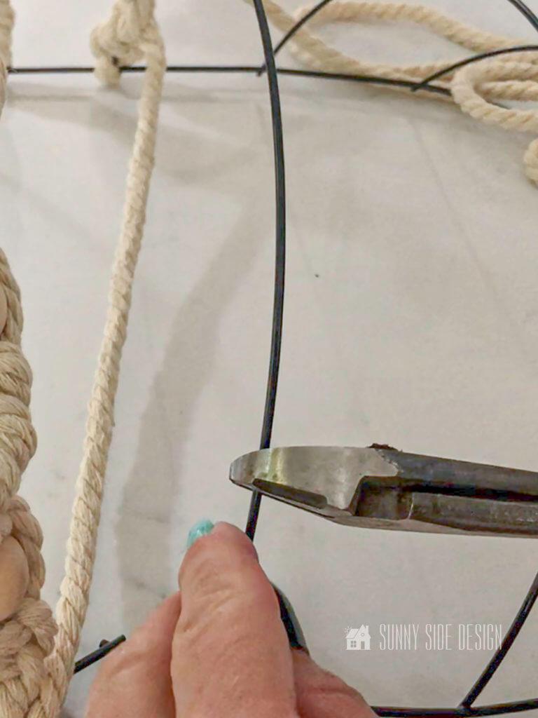 Cutting dykes snipping pumpkin wire wreath frame.
